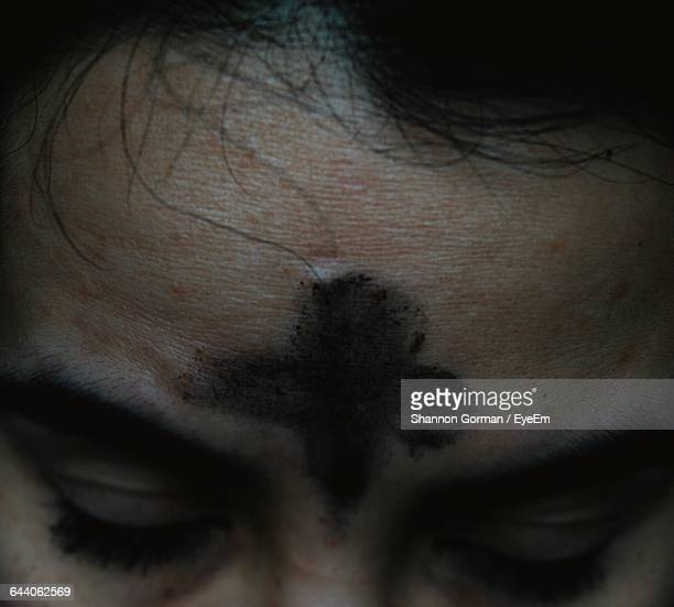 Cropped Image Of Person With Ash Cross On Forehead