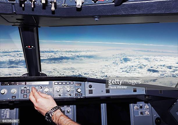 Cropped image of pilot in airplane cockpit