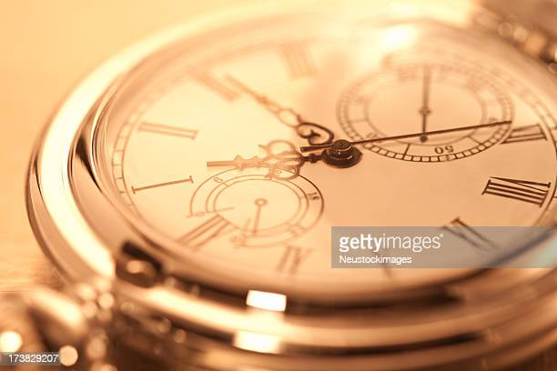 Cropped image of pocket watch