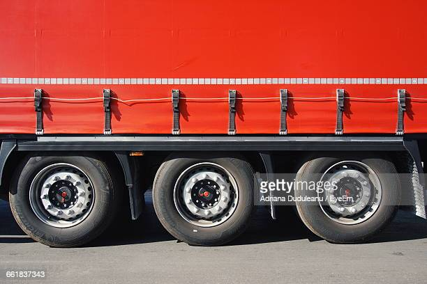 Cropped Image Of Red Truck On Road