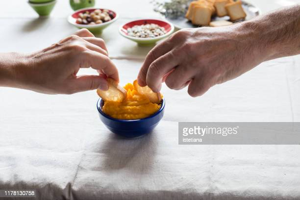 cropped image of senior couple hands having vegan snack together - dipping sauce stock pictures, royalty-free photos & images
