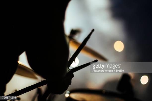 Cropped Image Of Silhouette Drummer Performing During Concert
