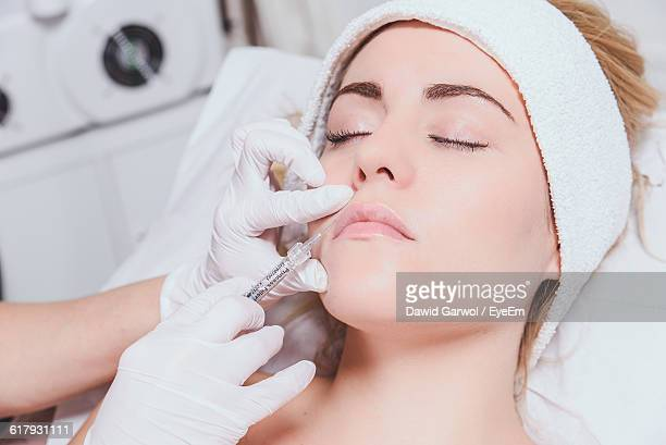 cropped image of surgeon doing anti aging therapy - botox stock pictures, royalty-free photos & images