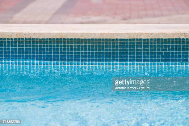 cropped image of swimming pool - poolside stock pictures, royalty-free photos & images