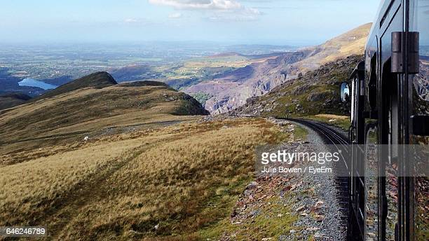 cropped image of train on mountain at snowdonia national park - snowdonia stock photos and pictures