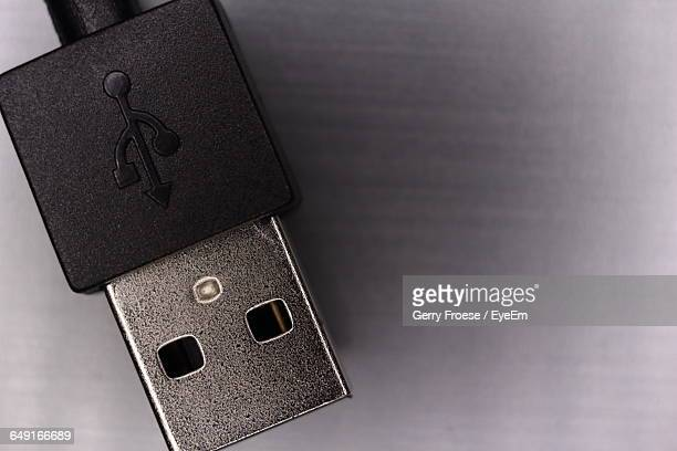 Cropped Image Of Usb Cable On Gray Background