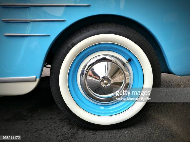 cropped image of vintage car on road - wheel stock pictures, royalty-free photos & images