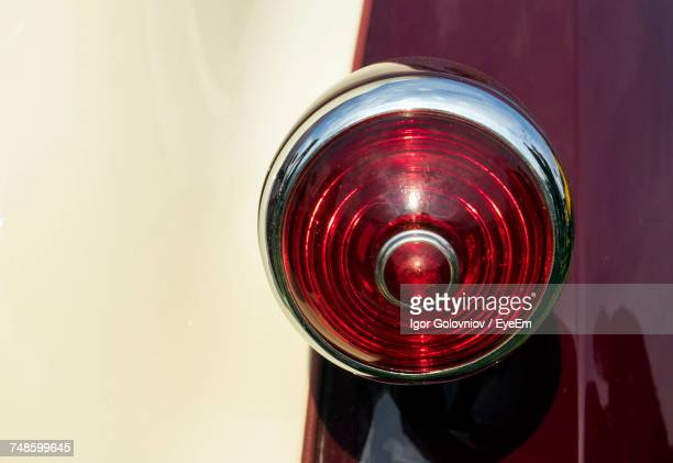 cropped image of vintage car tail light - tail light stock pictures, royalty-free photos & images