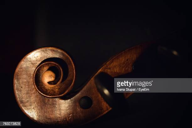 Cropped Image Of Violin Against Black Background