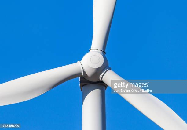 Cropped Image Of Wind Turbine Against Clear Blue Sky