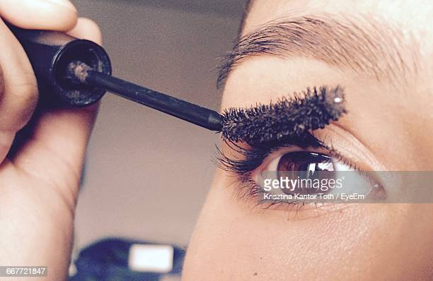 cropped image of woman applying mascara - eye make up stock pictures, royalty-free photos & images