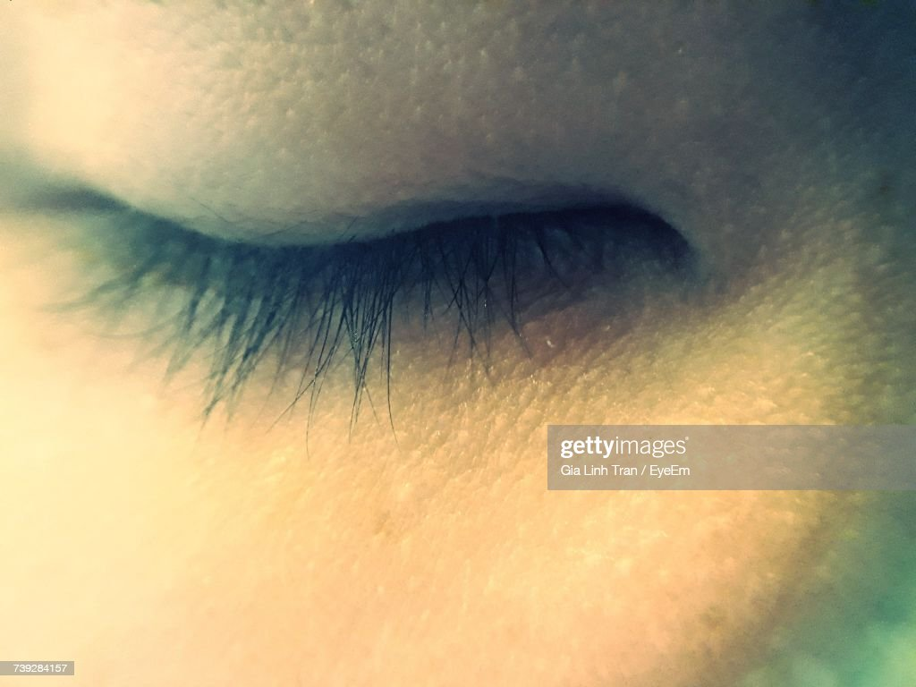 cropped image of woman closed eye stock photo getty images
