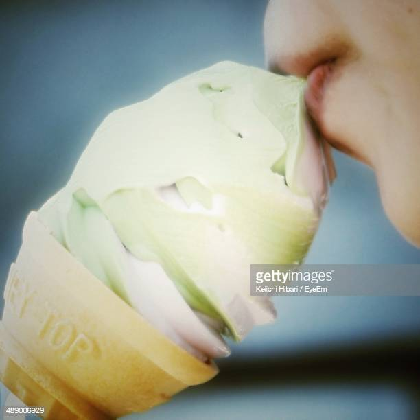 Cropped image of woman eating ice cream