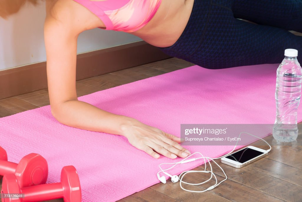 Cropped Image Of Woman Exercising At Home : Photo