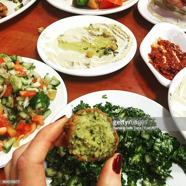 Cropped Image Of Woman Hand Holding Falafel