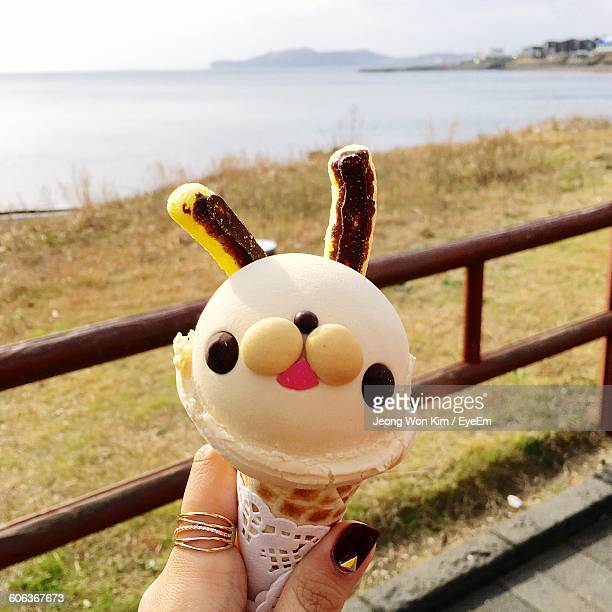 cropped image of woman hand holding ice cream - south korea stock pictures, royalty-free photos & images