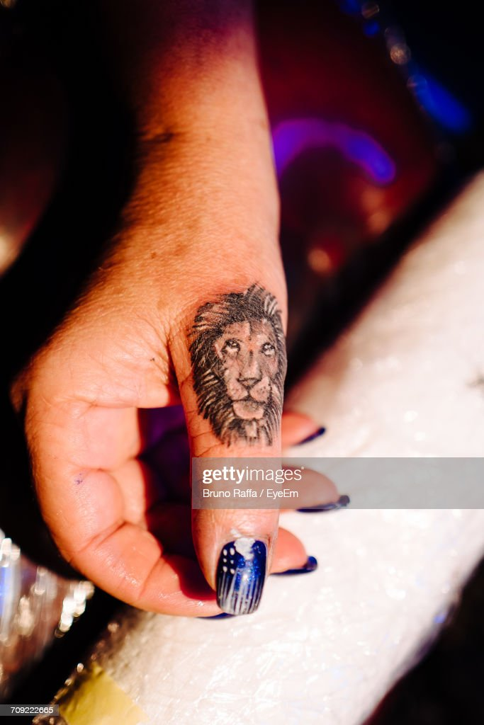 Cropped Image Of Woman Hand With Lion Tattoo Stock Photo Getty Images