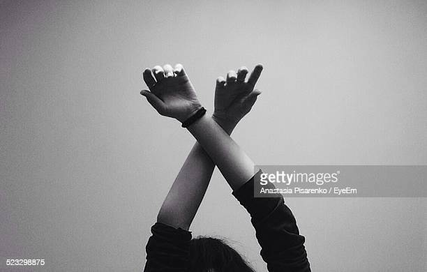 Cropped Image Of Woman Hands Against Wall