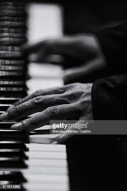 Cropped Image Of Woman Hands Playing Piano