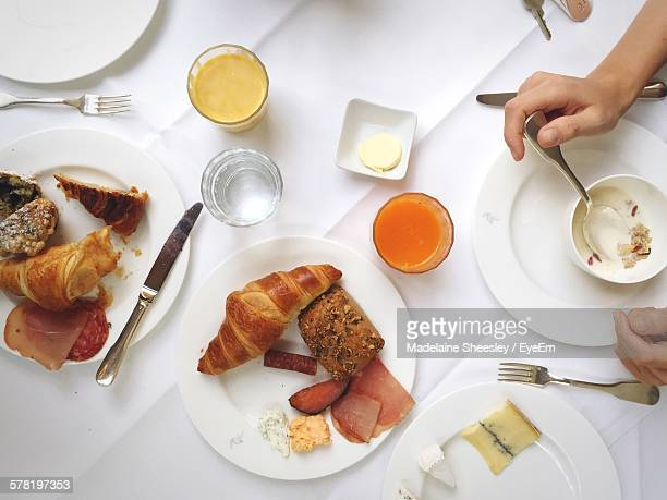 Cropped Image Of Woman Having Breakfast At Restaurant