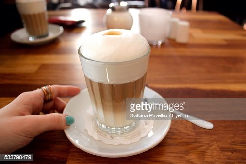 Cropped Image Of Woman Having Coffee In Restaurant