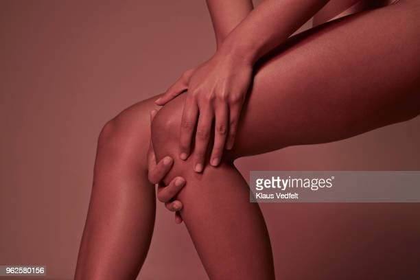 cropped image of woman having knee pains - inflammation stock pictures, royalty-free photos & images