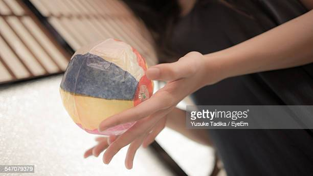 Cropped Image Of Woman Holding Paper Ball