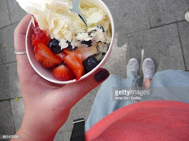 Cropped Image Of Woman Holding Salad In Disposable Cup