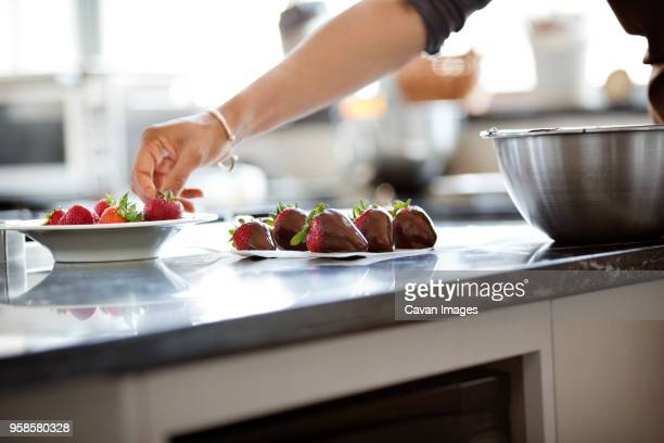 cropped image of woman holding strawberries - chocolate dipped stock pictures, royalty-free photos & images