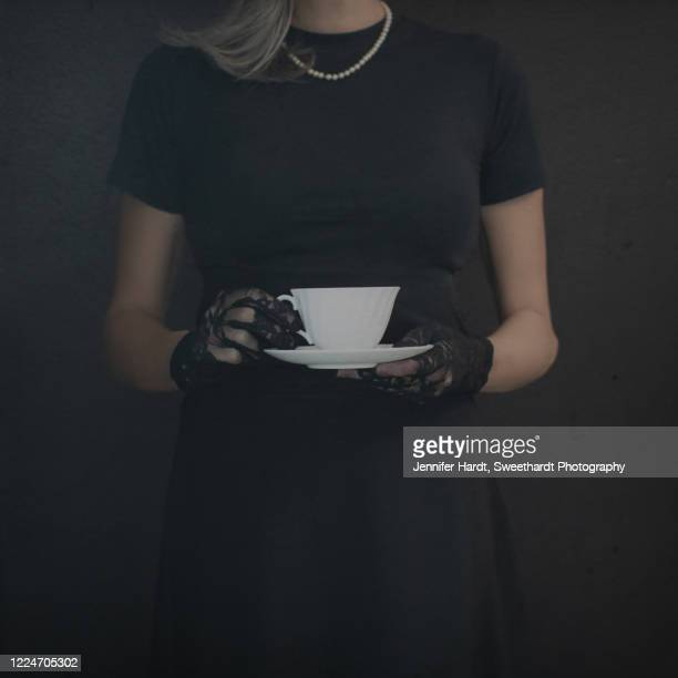 cropped image of woman holding tea cup wearing lace gloves - lace glove stock pictures, royalty-free photos & images