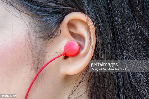 cropped image of woman listening to music - ear stock pictures, royalty-free photos & images