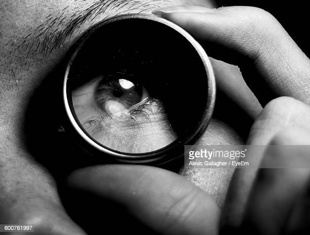 Cropped Image Of Woman Looking Through Lens