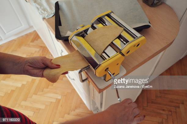 cropped image of woman making food at home - zuzana janekova stock pictures, royalty-free photos & images