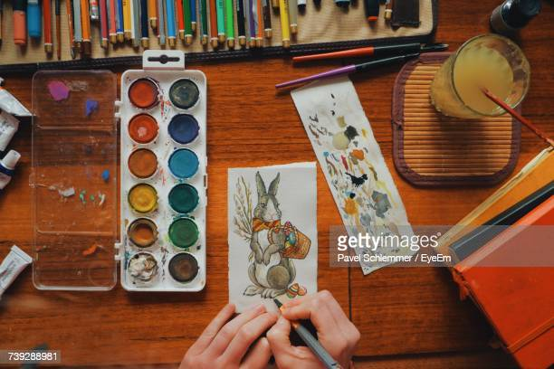 cropped image of woman painting easter bunny - easter bunny stock pictures, royalty-free photos & images
