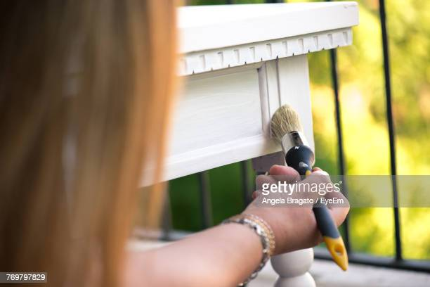 Cropped Image Of Woman Painting Furniture