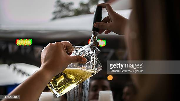 Cropped Image Of Woman Pouring Beer From Faucet At Pub