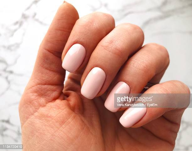 cropped image of woman showing painted fingernails - nail art stock pictures, royalty-free photos & images