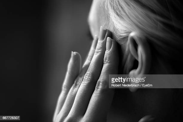 Cropped Image Of Woman Suffering From Headache