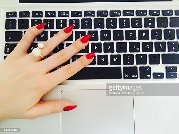 Cropped Image Of Woman Using Laptop