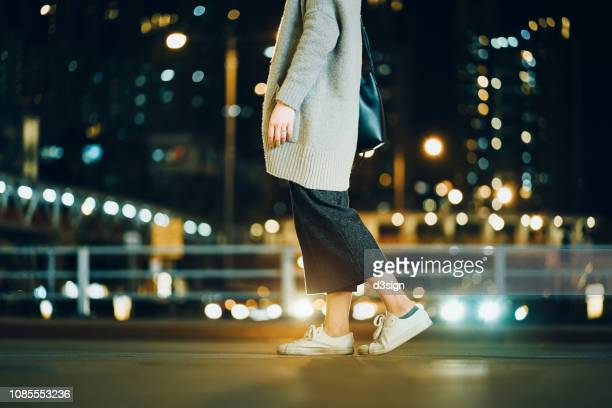 cropped image of woman walking in the illuminated urban city at night - asian women feet stock pictures, royalty-free photos & images