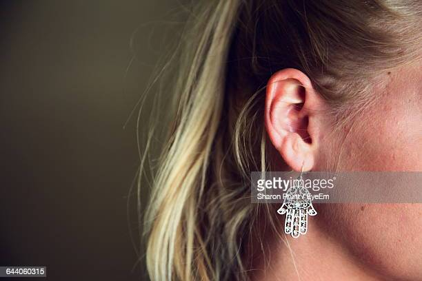 Cropped Image Of Woman Wearing Hand Shape Earring