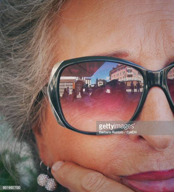 cropped image of woman wearing sunglasses - lady barbara stock-fotos und bilder