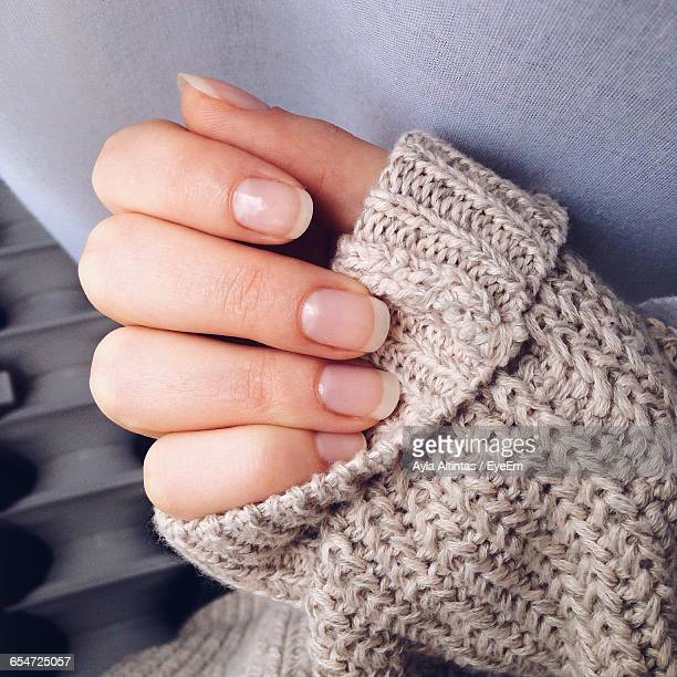 cropped image of woman wearing sweater - fingernail stock pictures, royalty-free photos & images