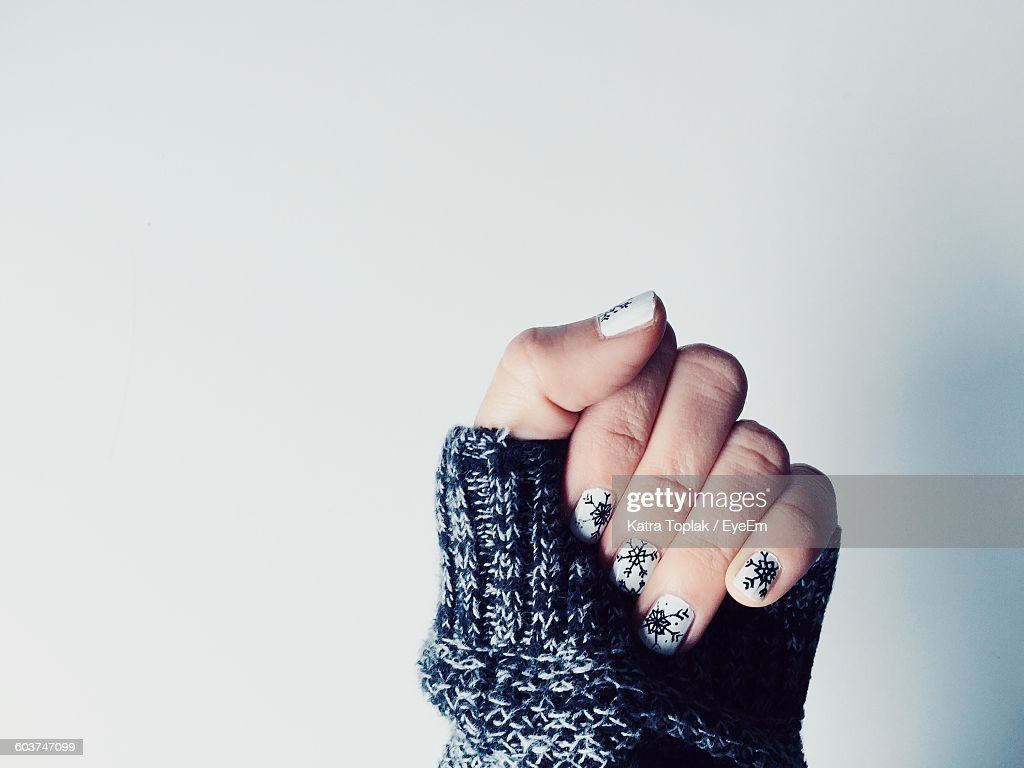 Cropped Image Of Woman With Nail Art Against White Background Stock
