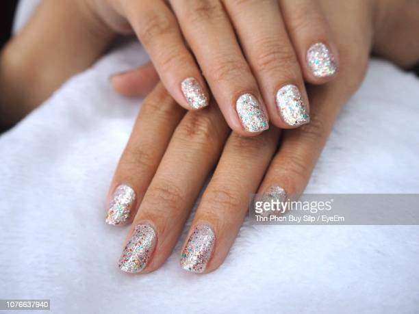 cropped image of woman with painted fingernails at home - nail art stock pictures, royalty-free photos & images