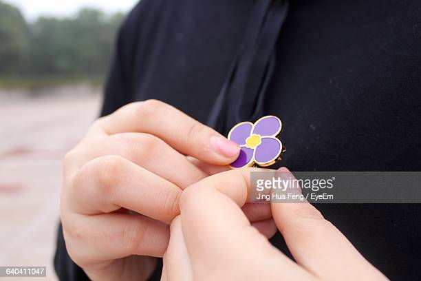Cropped Image Of Woman With Purple Brooch At Nanjing Normal University