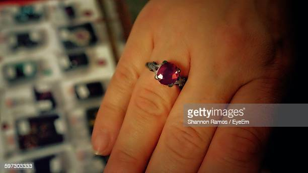 Cropped Image Of Woman With Red Ruby Ring On Finger