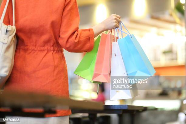 Cropped image of woman with shopping bags doing shopping in the mall