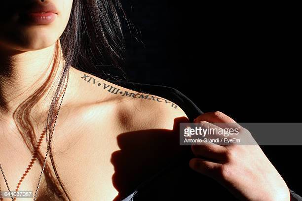 Cropped Image Of Woman With Tattoo On Shoulder