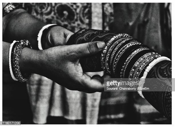 cropped image of women holding hands - kolkata stock pictures, royalty-free photos & images